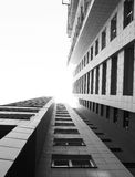 Skyscraper. Black and white building rushes up Royalty Free Stock Photo