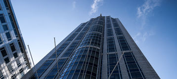 Skyscraper with blue skies Stock Images