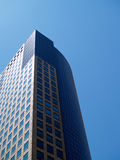Skyscraper and blue sky. Modern urban skyscraper or high rise offices with blue sky background Stock Image
