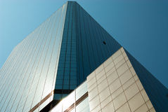 Skyscraper on blue sky stock images