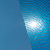Skyscraper and blue sky. Blue urban background royalty free stock images