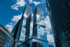 Skyscraper. Bottom view of modern glass skyscrapers in business district on a bright sunny day. Downtown cityscape Royalty Free Stock Photo