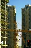 Skyscraper building. Office skyscraper building on construction with big crane Royalty Free Stock Image