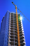 Skyscraper and building crane Royalty Free Stock Photo