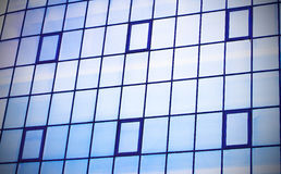 Skyscraper building windows and sky reflection in windows Royalty Free Stock Photography
