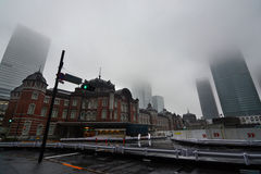 Skyscraper buildings around Tokyo Station disappear into thick morning fog in Japan`s urban capital Stock Photos