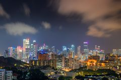 Skyscraper buildings and business downtown of Singapore at night Stock Photos
