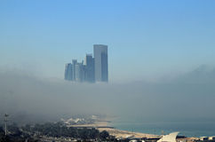 Skyscraper buildings on the coast surrounded by fog Stock Photography