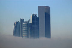 Skyscraper buildings surrounded by fog Royalty Free Stock Photography