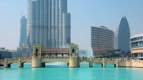 Skyscraper Burj Khalifa and singing fountains in Dubai, United Arab Emirates stock video footage