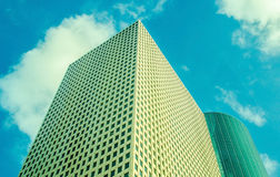 Skyscraper in the cap of clouds Royalty Free Stock Photography