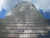 Skyscraper with clouds. Skyscraper with a reflection of the sky with clouds Stock Image
