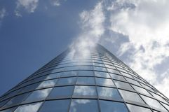 Skyscraper in the clouds Royalty Free Stock Image