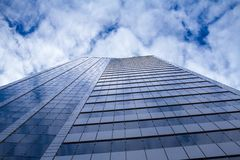 Skyscraper & clouds Royalty Free Stock Images