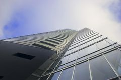 Skyscraper on cloudy sky. Office building Skyscraper on cloudy sky from low angle Stock Photo