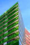 Skyscraper with coloured walls. A modern skyscraper, equipped with green, blue and red coloured glass walls Stock Photography