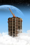 Skyscraper construction over the clouds Stock Photos