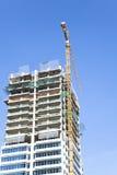 Skyscraper Construction with Yellow Gantry Crane Stock Photos