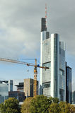 Skyscraper with crane in front of it on site Stock Image