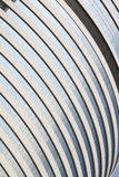 Skyscraper details: lines, curves and glass window Royalty Free Stock Image