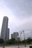 Skyscraper in downtown. Skyscraper in town. shows business, cityscape, successful,booming economy. Road also adds to city look Stock Photography