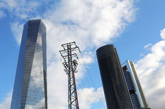 Skyscraper and electrical pillar Stock Photos