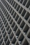 Skyscraper facade showing grid of concrete girders Royalty Free Stock Photo