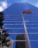 Skyscraper and flag, Houston, USA. Stock Photography