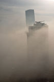 Skyscraper in fog Stock Photography
