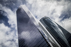 Skyscraper with glass facade and clouds reflected in windows Royalty Free Stock Photo