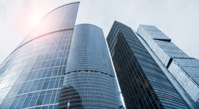 Skyscraper glass facades on a bright sunny day with sunbeams in the blue sky. Modern buildings in Moscow business district Royalty Free Stock Image
