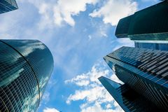 Skyscraper glass facades on a bright sunny day with sunbeams in the blue sky. Modern buildings in Moscow business district Stock Photography