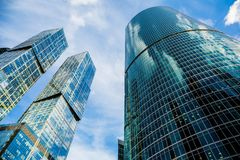 Skyscraper glass facades on a bright sunny day with sunbeams in the blue sky. Modern buildings in Moscow business district Stock Photo