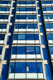 Skyscraper glass windows. Office block skyscraper glass windows Stock Images