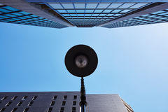 Skyscraper with lamppost and sky Stock Image