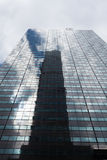 Skyscraper low angle view with reflections, New York City Royalty Free Stock Image