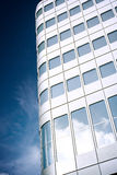 Skyscraper. A modern skyscaper with clouds reflections Royalty Free Stock Photography