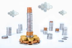 Skyscraper of money in capital city of coins financial concept.  royalty free stock photo