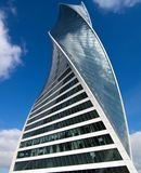 Skyscraper of the Moscow business center. With the blue sky and clouds at the background. DNA, evolution Royalty Free Stock Images