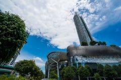 Skyscraper near Marina Bay Sands over blue summer sky background Stock Photography