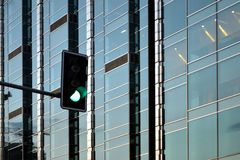 Skyscraper, office building, green light. Skyscraper, office building with glass walls, green light Royalty Free Stock Photography