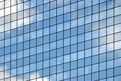 Skyscraper, office building, windows. Skyscraper, office building with glass walls, detail Royalty Free Stock Images