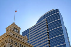 Skyscraper and old building. Low angle view of modern skyscraper with old building in foreground; downtown Portland, Oregon, U.S.A Stock Photo