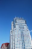 Skyscraper over blue sky. View of a skyscraper over a blue sky Stock Image