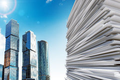 Skyscraper with pile of paper Stock Photo
