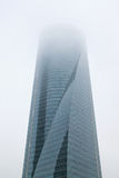 Skyscraper in the polluted gases city. Royalty Free Stock Photo