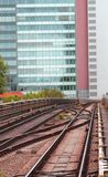 Skyscraper and the rails of the train for commuter transport in Royalty Free Stock Images