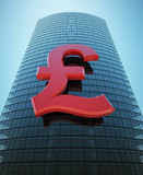Skyscraper with red pound sign Stock Images