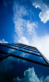 Skyscraper reflecting clouds Royalty Free Stock Photo