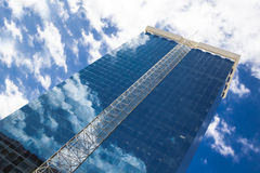 Skyscraper reflecting clouds in the sky Royalty Free Stock Photo